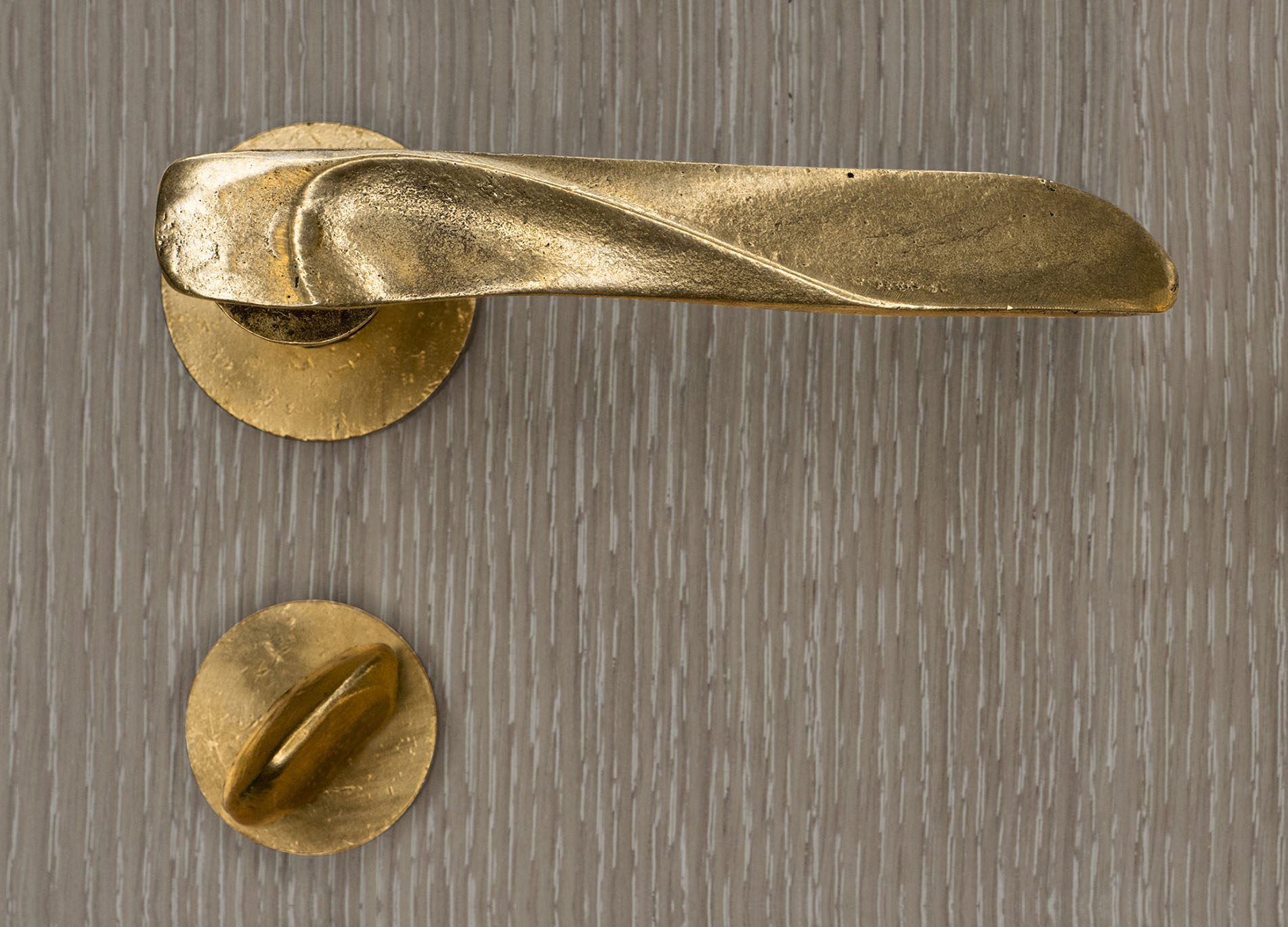 Versa lever: - Artist Mig Perkins designed this lever with an acute awareness of the grip and where the thumb falls. With a natural brass finish, the result is a sculpted and functional piece of artwork for the home.