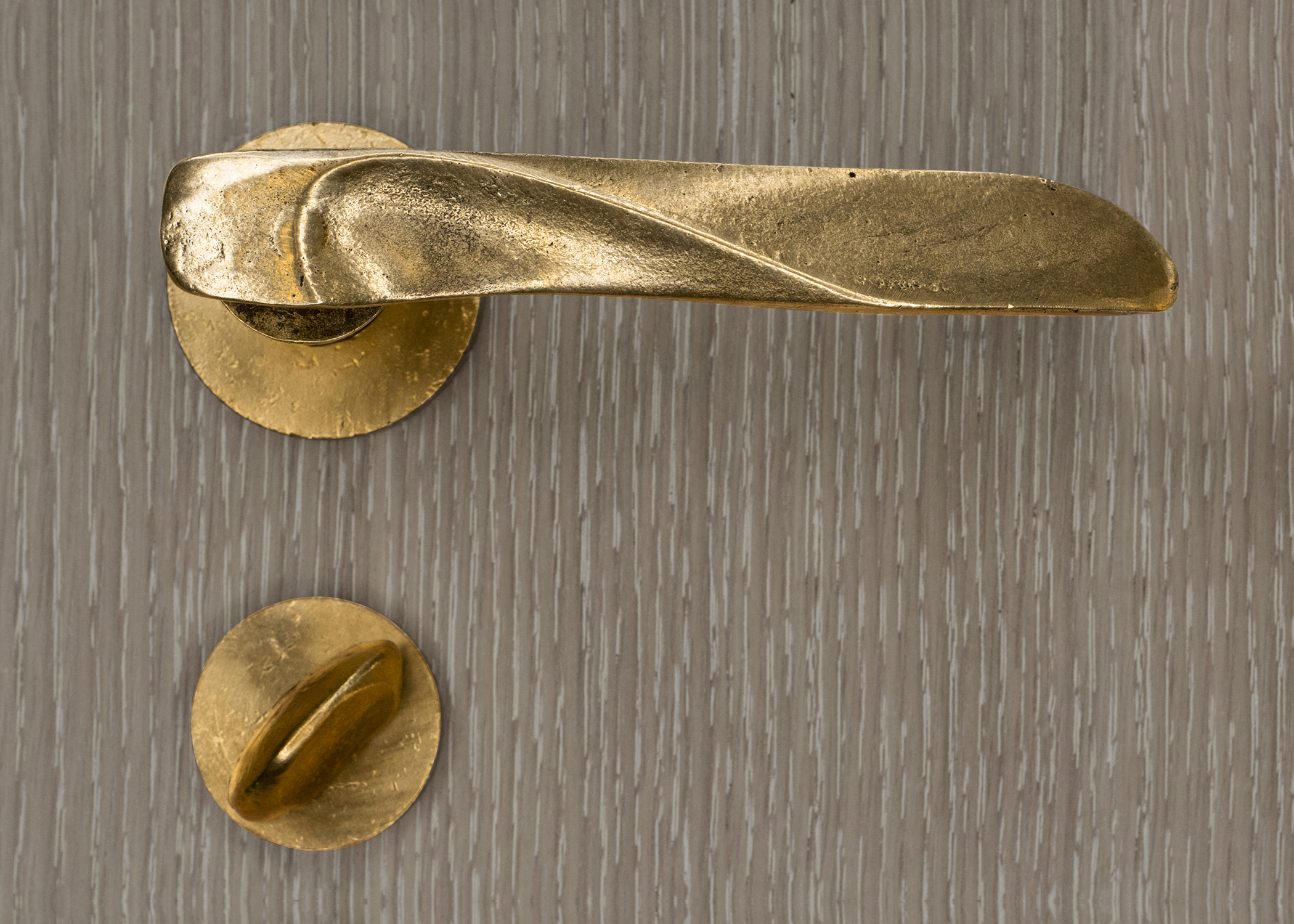 The Versa lever  in natural brass, designed by Mig Perkins