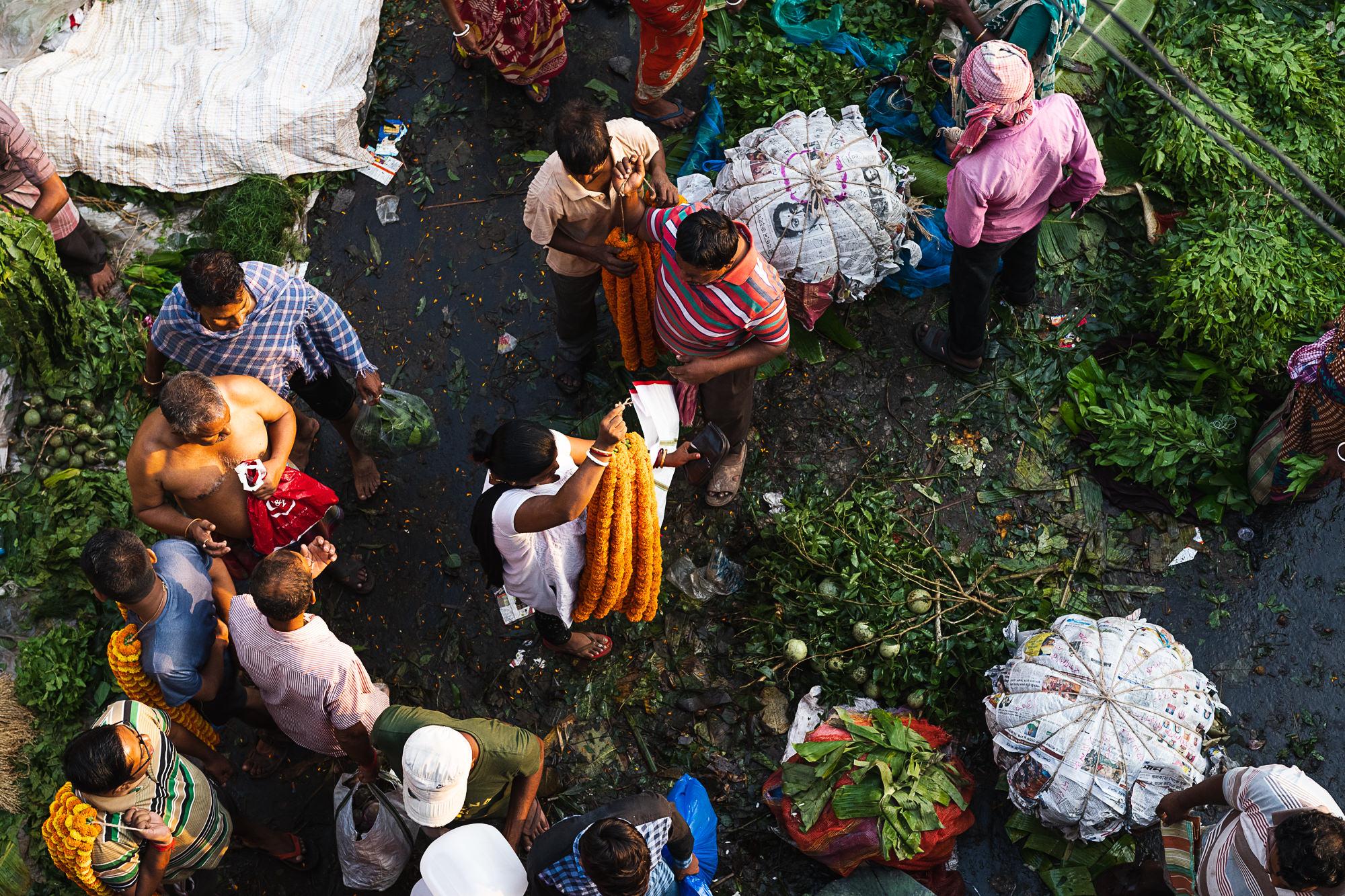 Mallik Ghat Flower Market - top view of transaction in progress