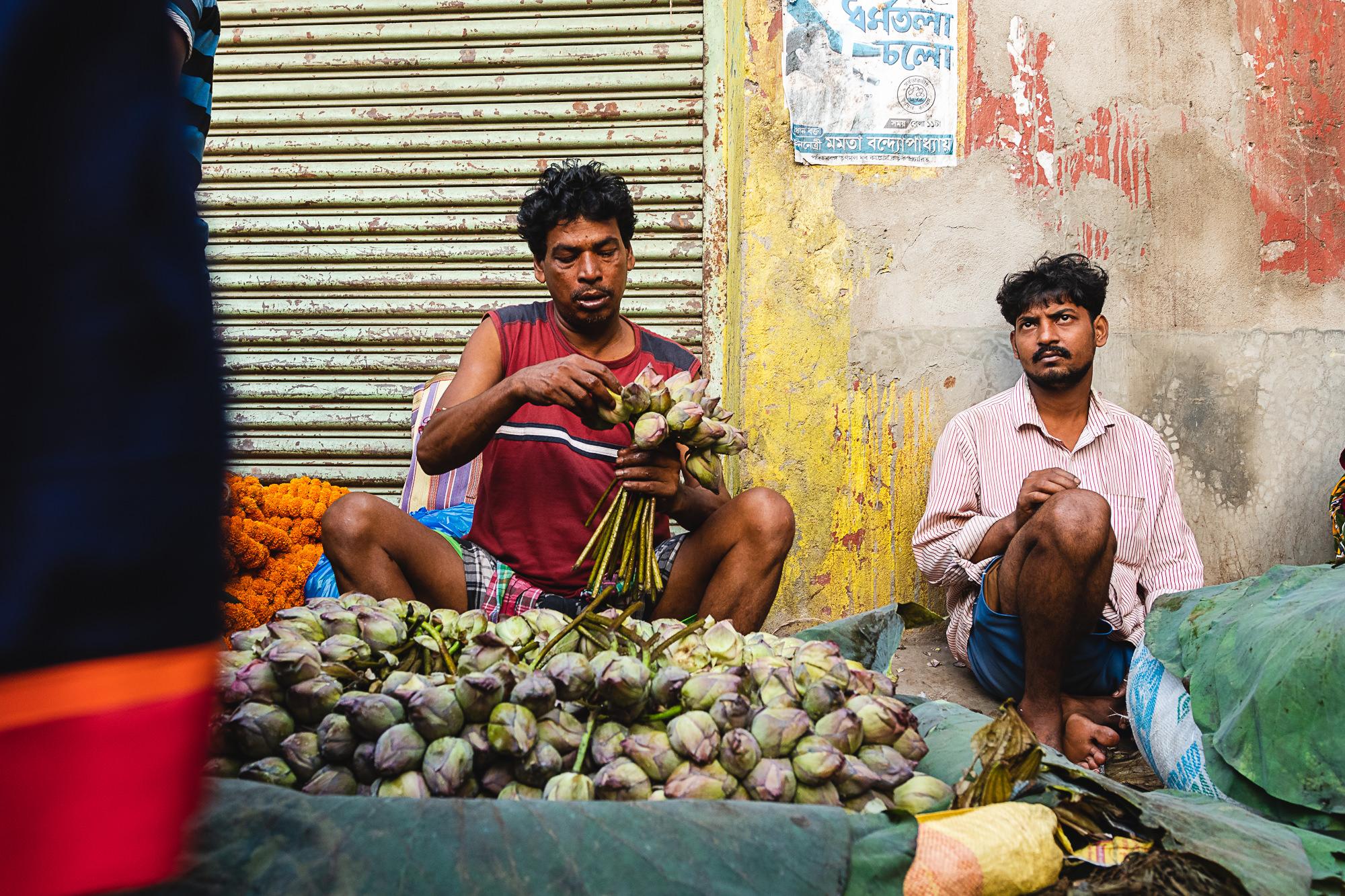 Mallik Ghat Flower Market - vendor selling lotus