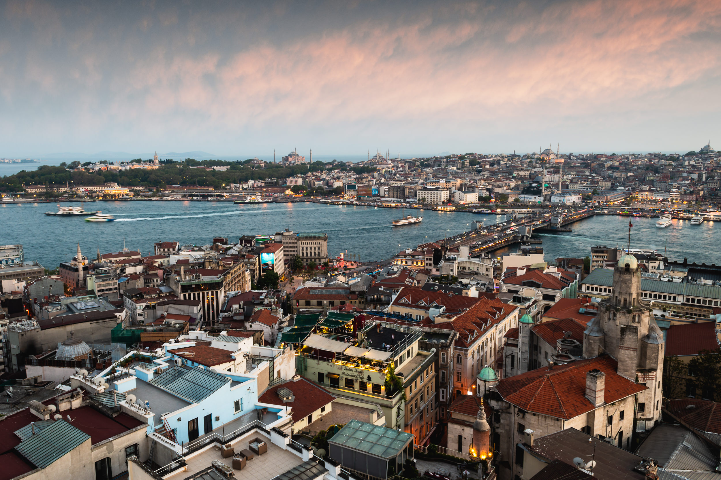 View of Istanbul from the top of the Galata Tower. Hagia Sophia and Blue Mosque can be seen in the background. The Galata Bridge connects the new and old parts of the city.