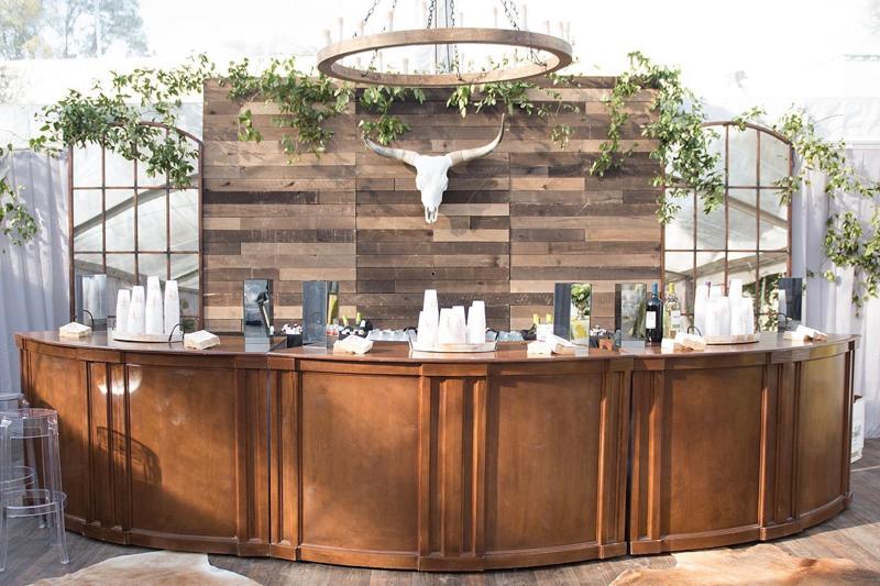 curved wood bar, windowpane mirrors, wood wall, bar back with mirrors and wood