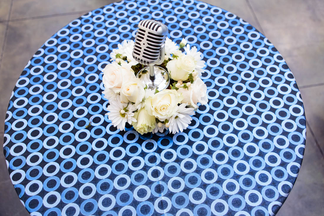 blue linen, linen with blue circles, microphone centerpiece, circled pattern table linen