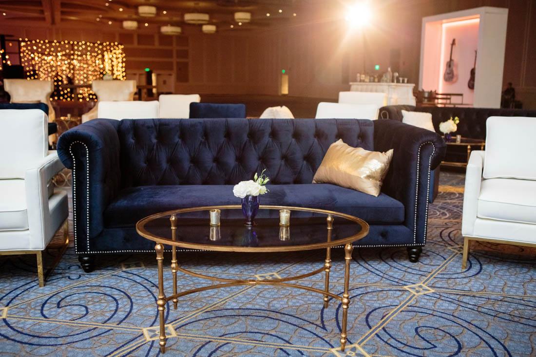 blue sofa, velvet sofa, gold coffee table, gold pillow
