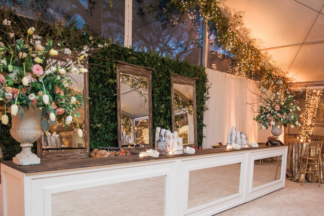 hedge wall, white bar with mirror, tall mirrors