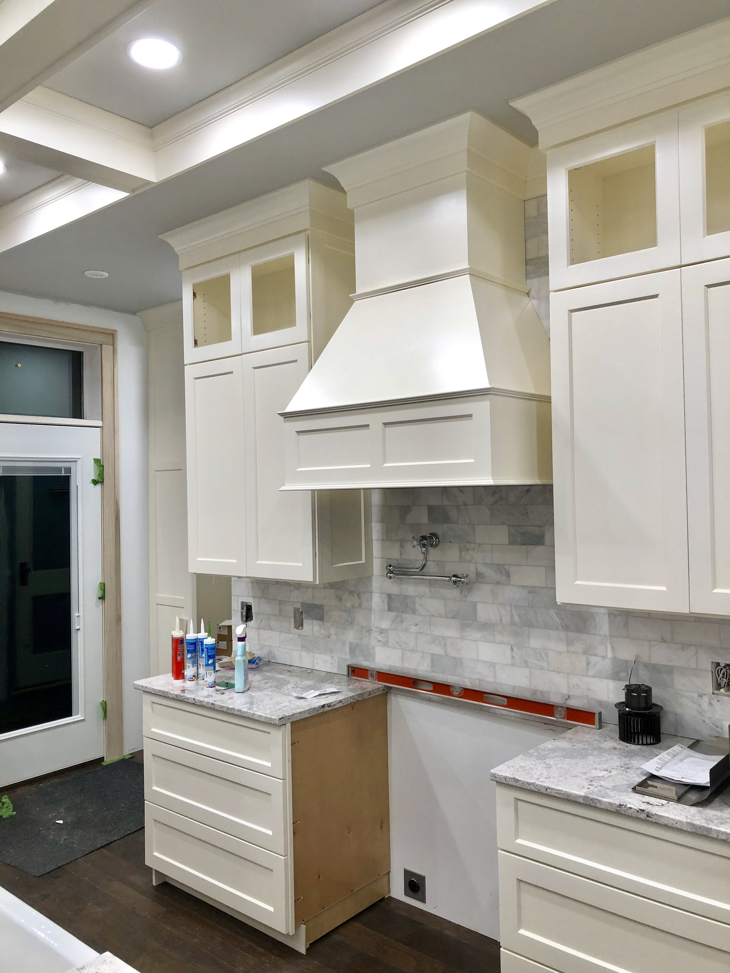 White kitchen hoods, and grout, and appliances (almost ...