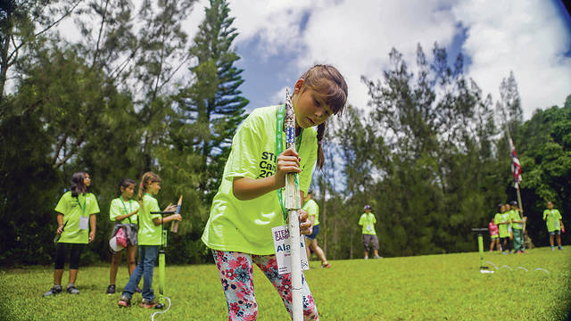 COURTESY GIRLS SCOUTS OF HAWAII A Girl Scout named Alana, above, prepared Saturday to launch the rocket she made at STEM Camp at Camp Paumalu on the North Shore.
