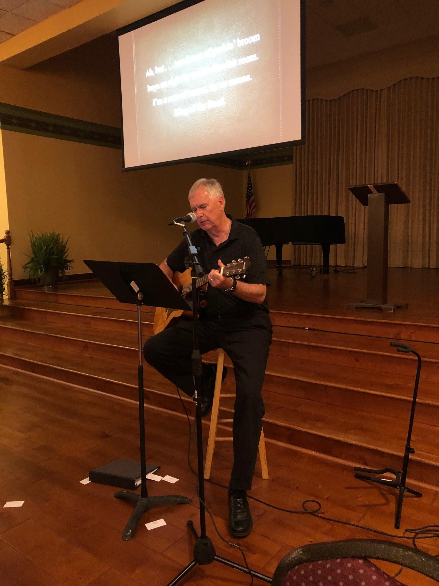 Emcee Jeff Jenkins leads a sing along