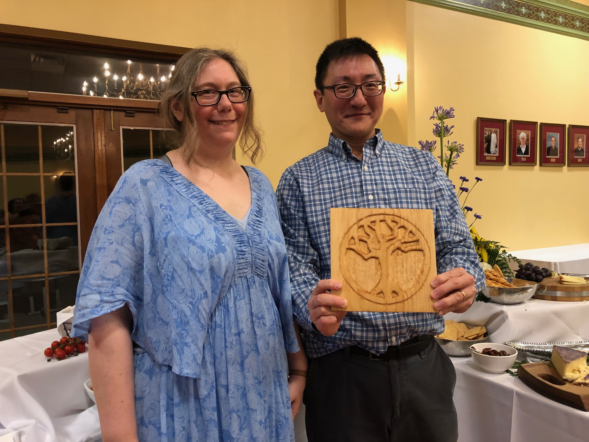 Soprano Emily & tenor Ben Tsai with a wood carving made by Bob Shafer