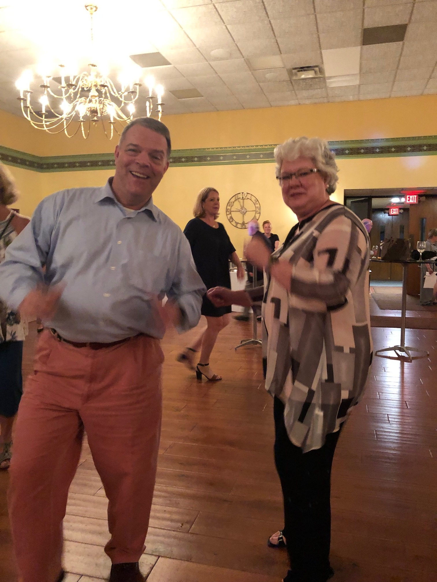 Bass Howard Lincoln & wife Kathy cut a rug