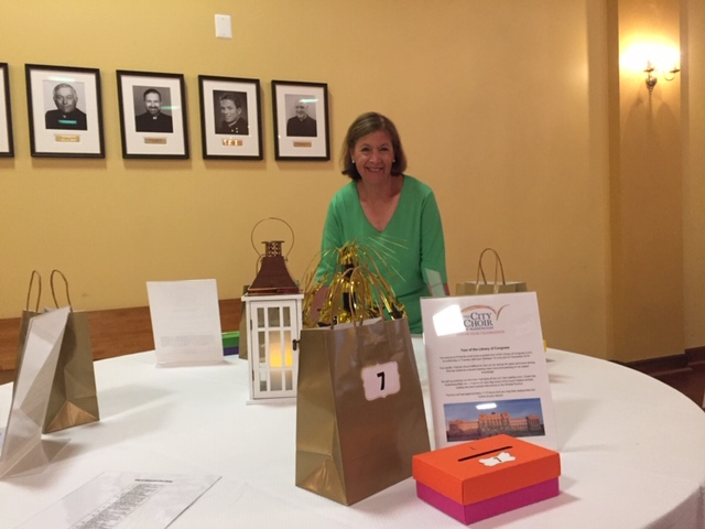 Celebration Committee co-chair Barbara Greene at a silent auction table