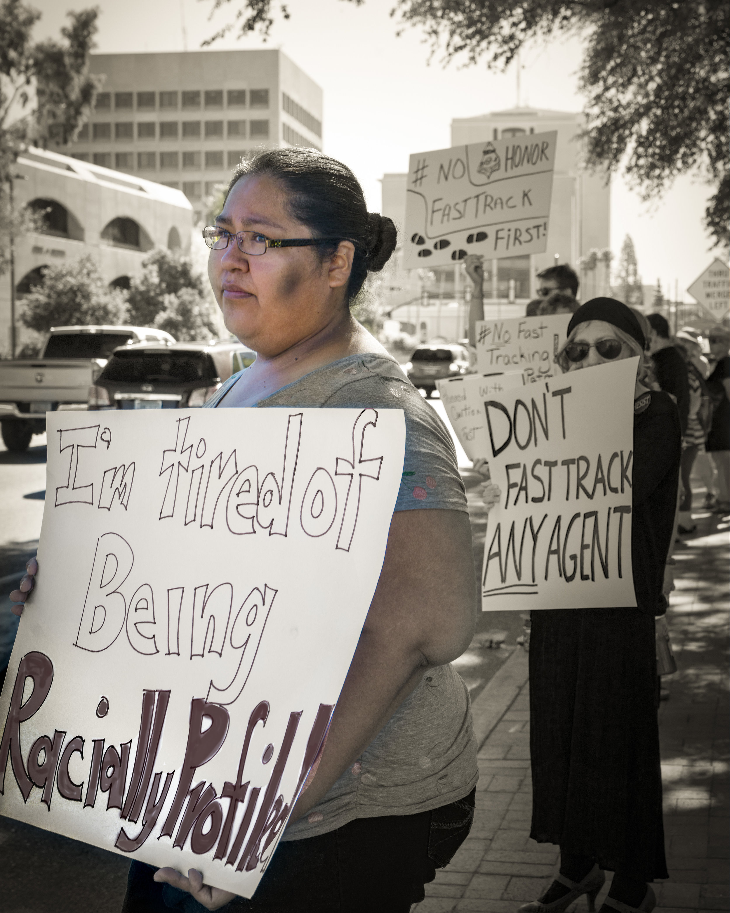 """May 23, 2017 Tucson, AZ: Gabriella Cazares-Kelly, a member of the Tohono O'odham Nation, is an educator and community organizer. She writes: """"In my community, Border Patrol agents have been known to question without cause, verbally harass, drive recklessly, damage property, intimidate and physically assault tribal members. Our community is already militarized.""""  Title: Tired  Medium: Digital Print on Aluminum with frame  Size: 16 x 20  Year of creation: 2017  Price $350  For sales inquiries, please contact dlutzick@yahoo.com with Winslow Arts Trust Museum"""