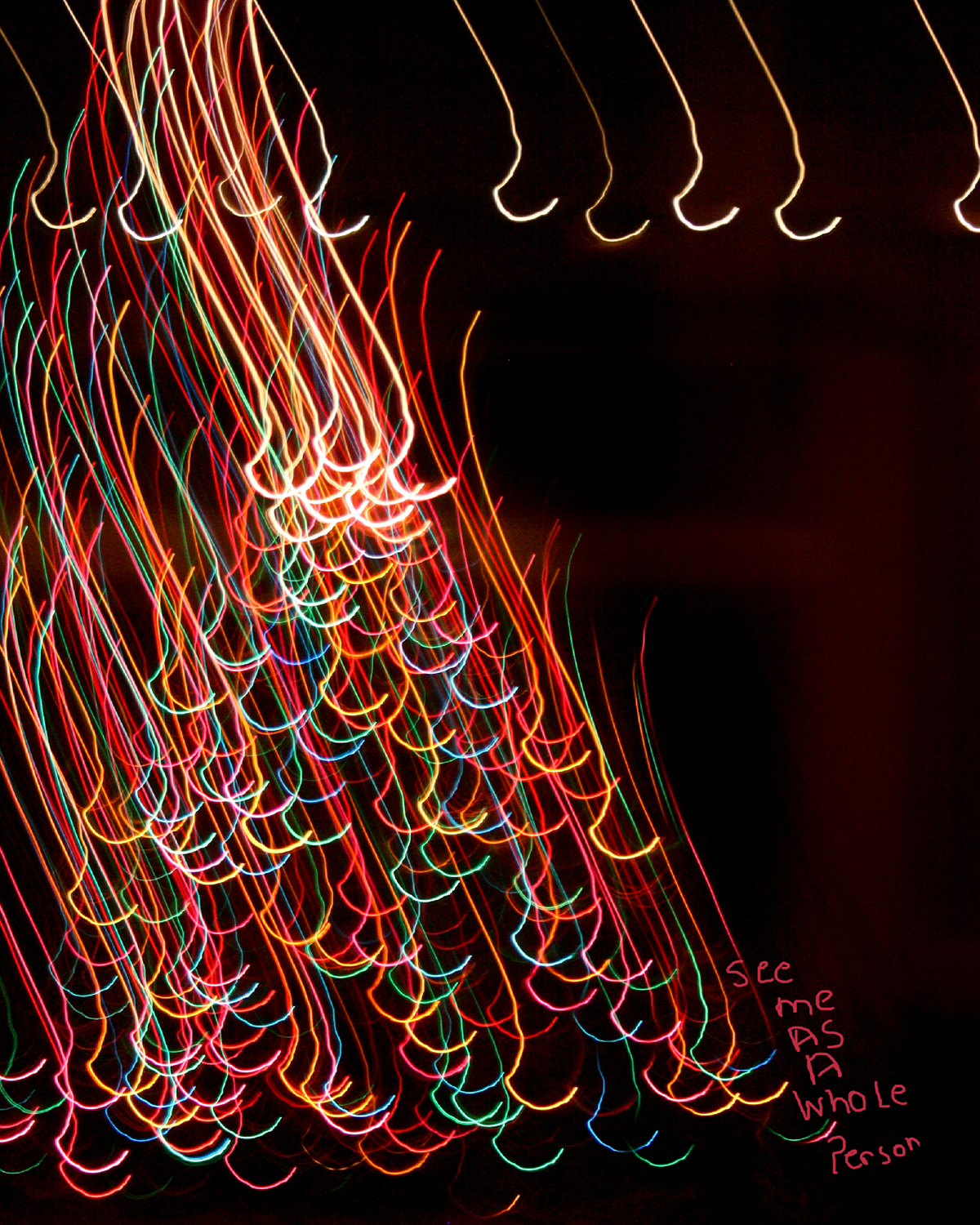 These photographs were created at night using a slow shutter speed and colored lights. Afterward, I looked at each abstract image and felt that they described how I, as a differently abled person, feel sometimes. The darkness that surrounds the light paintings merely acts to show the beauty of the colors and shapes. These photographs represent the positivity of being differently abled and the hope that the world would accept me as I am.  Title: See Me AS I Really Am  Medium: Photography/Digital Arts  Size: 8 x 10  Price $200  For sales inquires, please contact dlutzick@yahoo.com with Winslow Arts Trust Museum