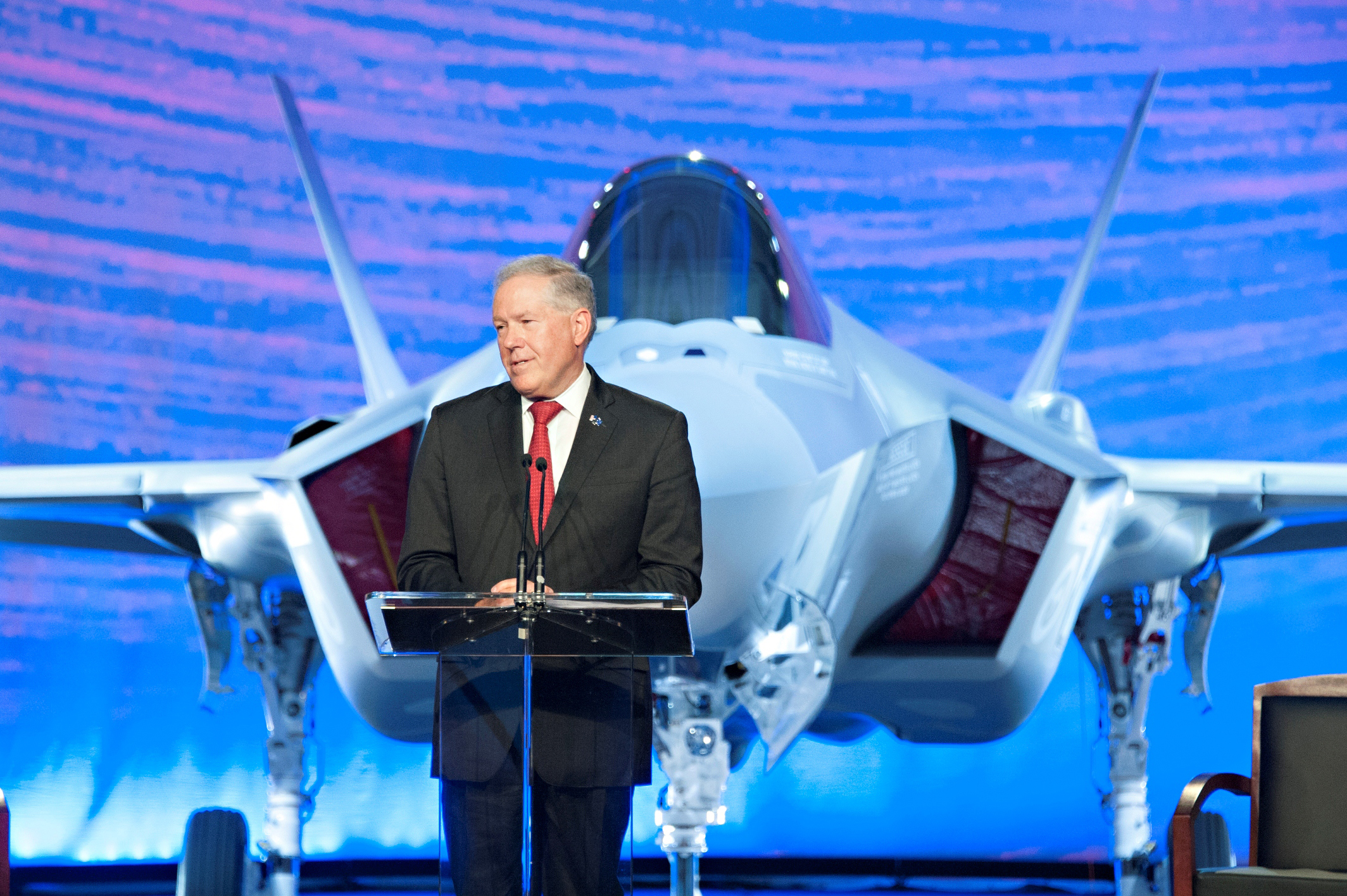 Frank Kendall, undersecretary of defense for acquisition, technology and logistics, speaks at a roll-out ceremony for the first two F-35 Lightning II joint strike fighter aircraft for the Royal Australian Air Force at Lockheed Martin in Fort Worth, Texas, July 24, 2014. Kendall said the aircraft represents an exponential leap in capability on the cutting edge of technology, and is an integral component of the ongoing U.S. and Australian commitment to stability in the Asia-Pacific region. (Department of Defense)