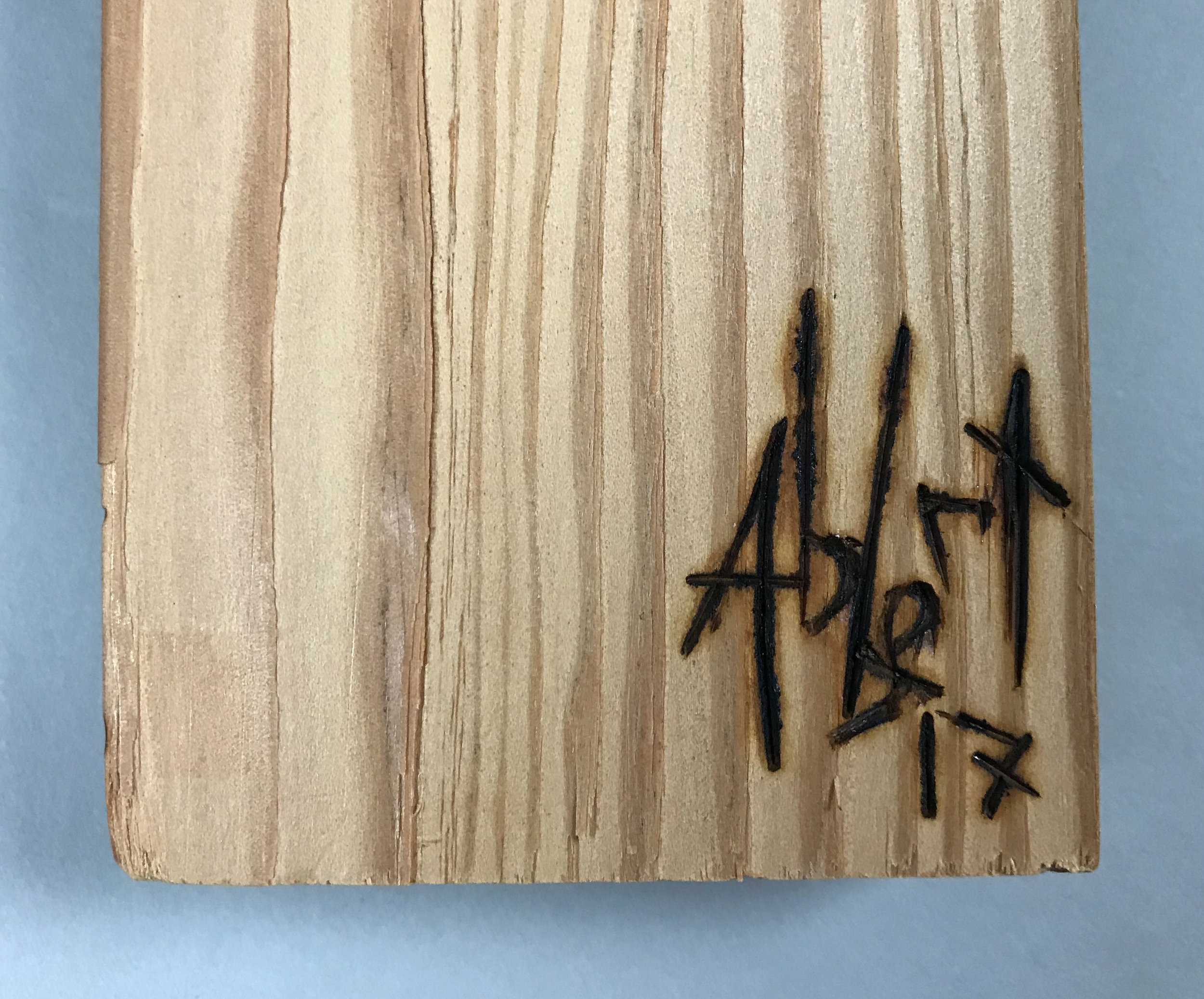 Most pieces are signed with wood burner. Some painted on side and back.