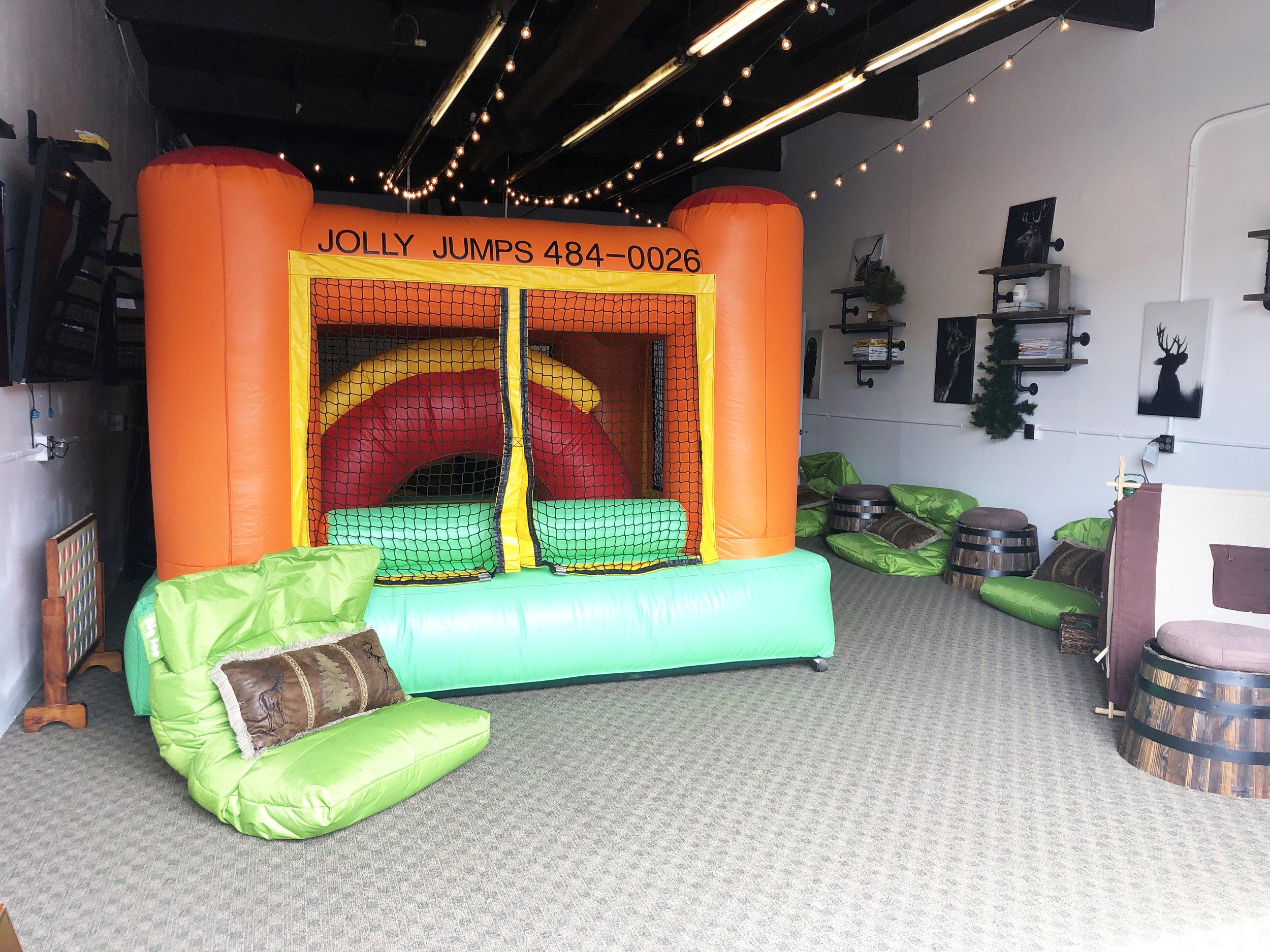 Jolly Jumps bounce house setup at The Papa Saloon