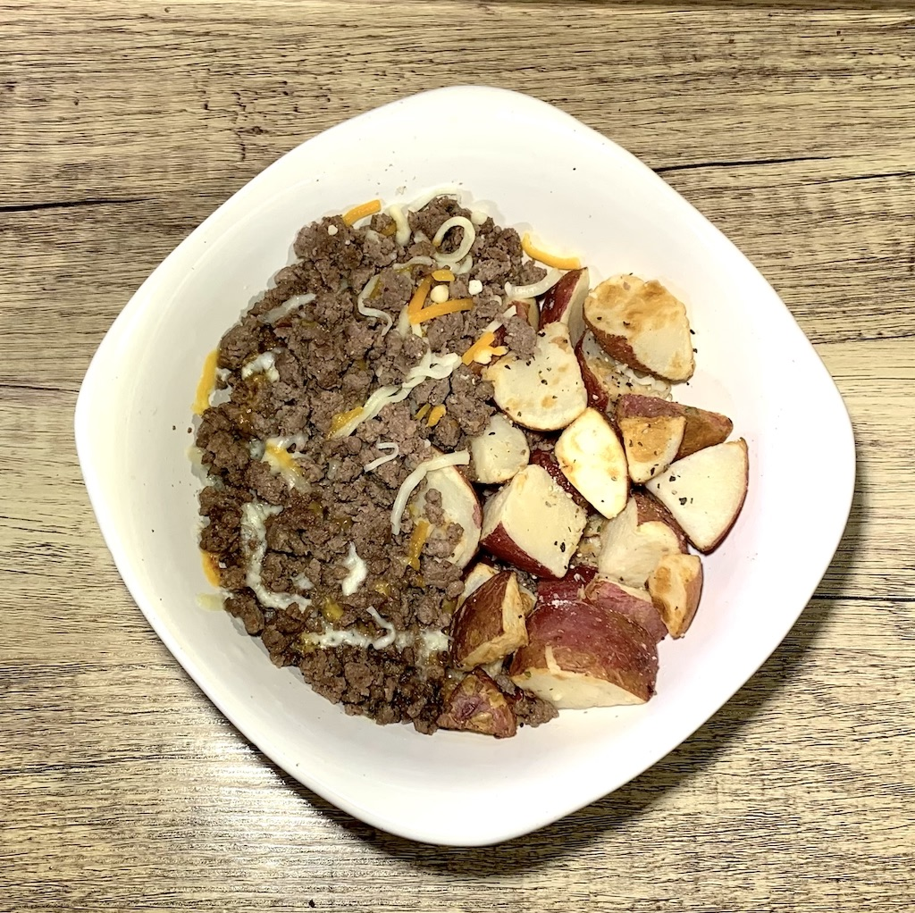 Cheeseburger Bowl - Calories: 375Carbs: 26 gramsFat: 15 gramsProtein: 34 gramsContains: dairy