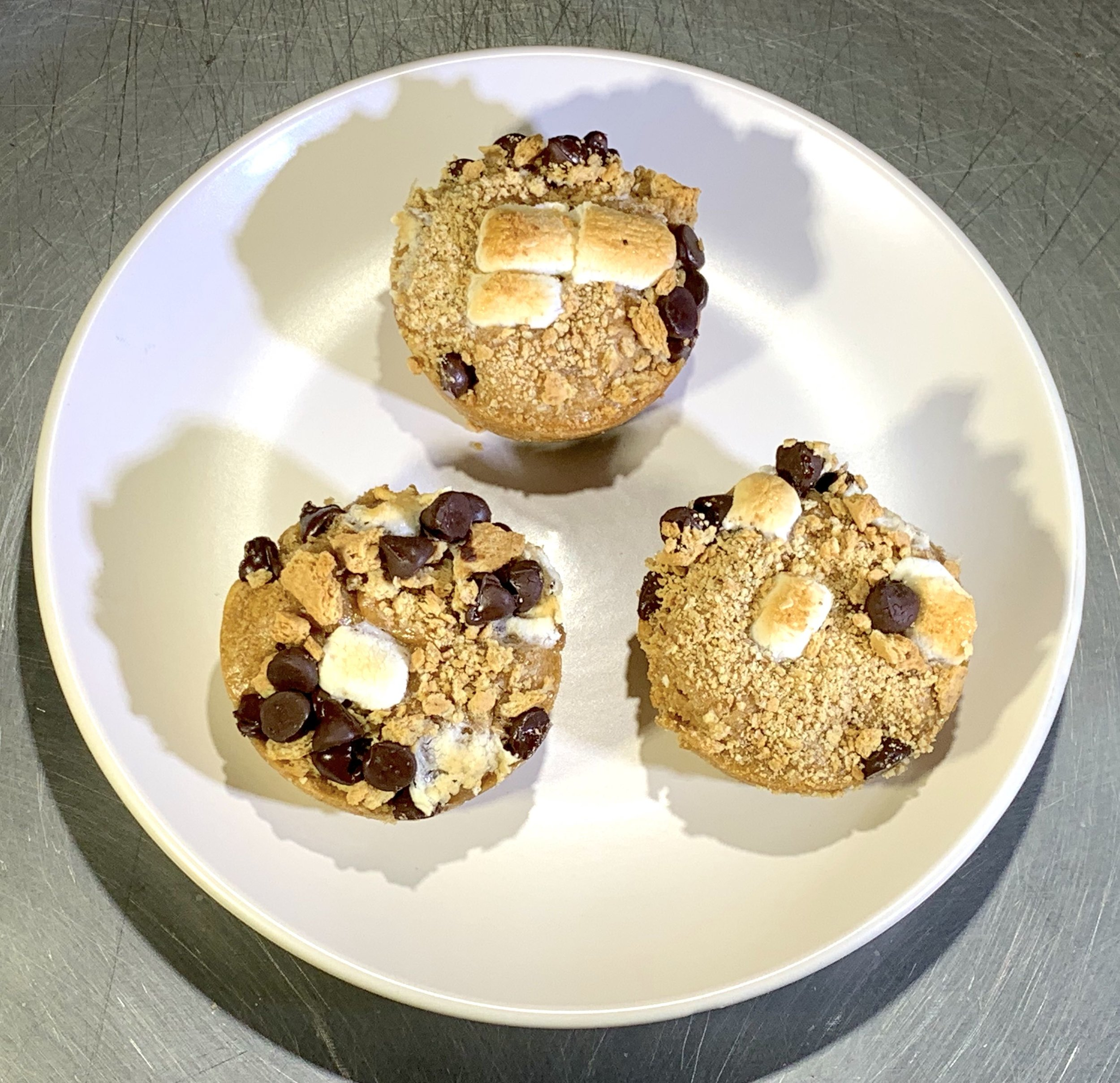 S'mores Protein Muffins - Calories: 411 Fat: 27 gramsCarbs: 21 grams Protein: 21 gramsContains: peanut, eggs, dairy