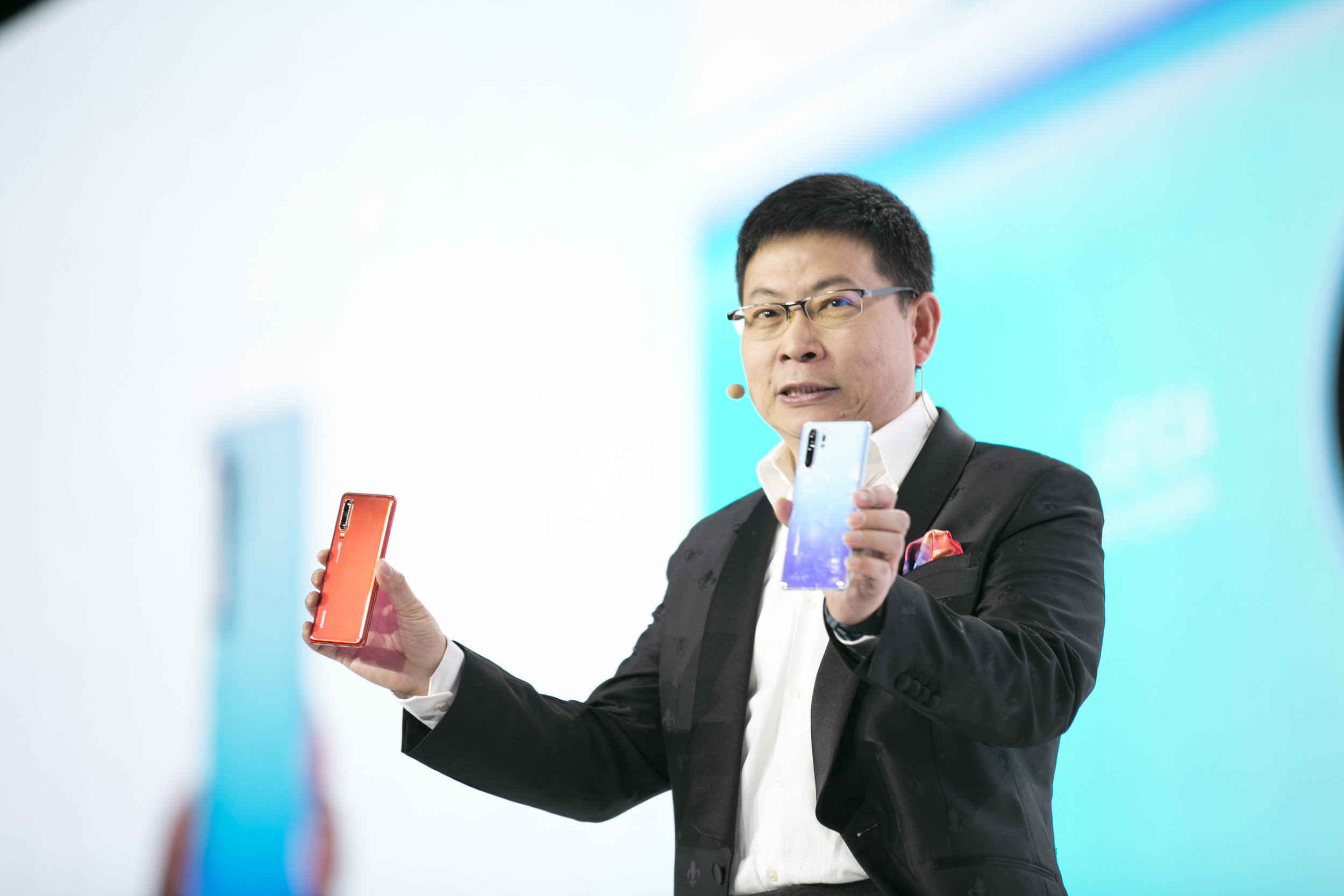 CEO Richard Yu with the new HUAWEI models  Credit: Evan Doherty