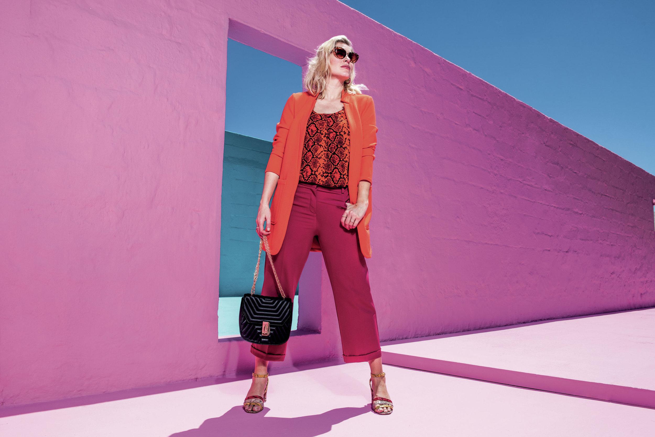 1. JD Williams Deep Orange Crepe Jacket; Snake Print Vest; Camilla Crop Turn Up Trousers; Three Strap Square Heeled Sandals and Black Quilted Shoulder Bag