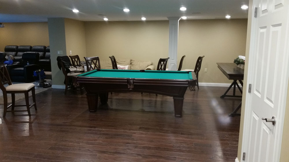 pool_table_in_living_room_luxury custom_home_builders.jpg
