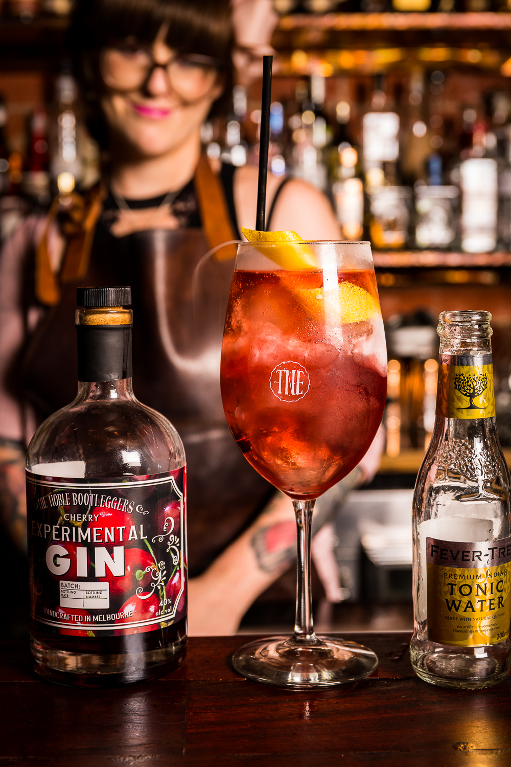 Noble Bootleggers Cherry Gin & Tonic - 30mls Noble Bootleggers Cherry Gin120mls Quality Indian Tonic WaterLemon peel garnishBuild all ingredients into a highball glass, add ice and top with tonic. Garnish with a lemon peel twist.