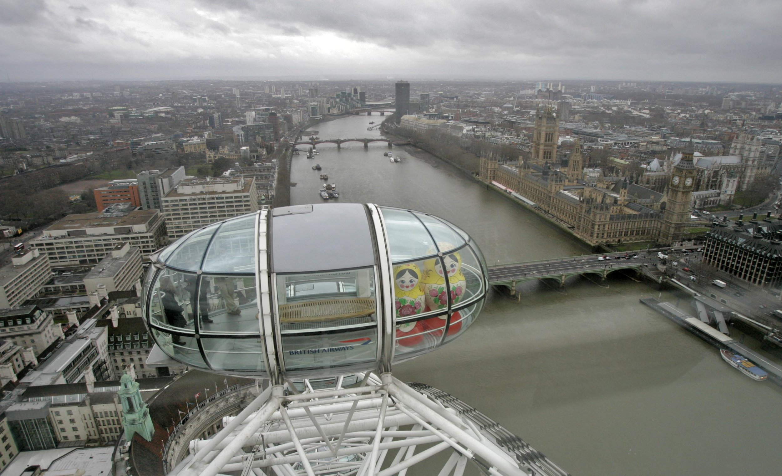Dolls in London Eye pod with parliament and river.jpg