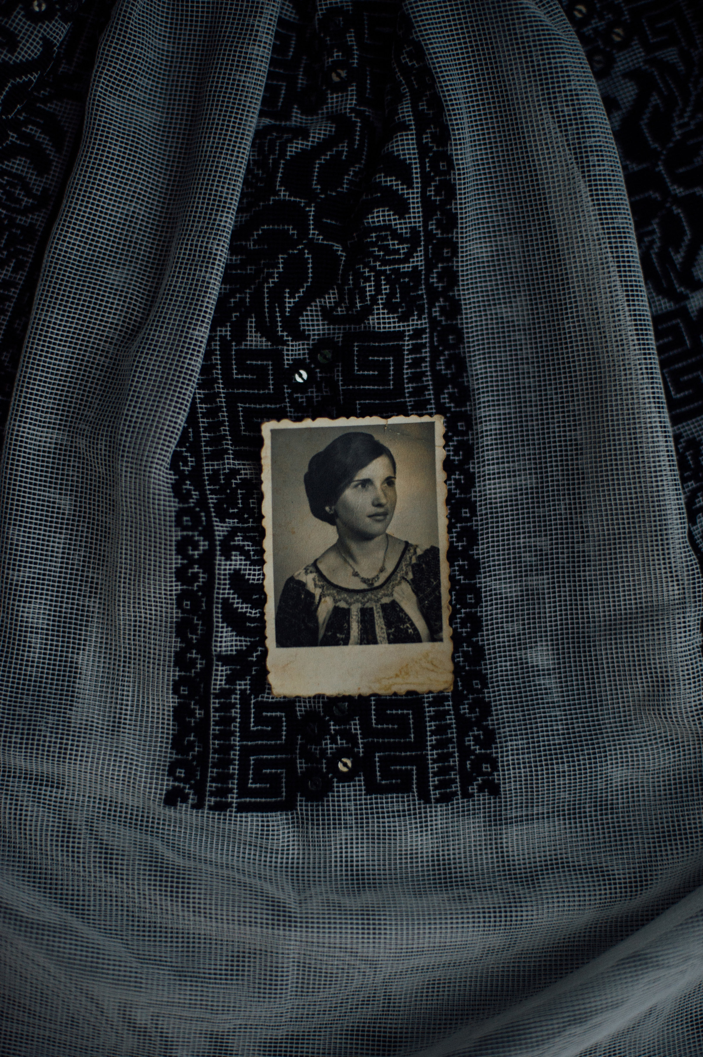 """A holiday blouse Adina's mother made and embroidered as a young girl was already special to her when she wore it for this portrait of her at 18. Adina loves these wearable traces of the past, pulling them out from time to time to wear for special occasions or to dress her girls in. She says, """"At one point in time I was thinking about framing them to preserve them, but that meant I won't be able to touch them anymore and I decided not too. I like to see them on my girls and tell them: 'This was made by my mother's hands.'"""""""