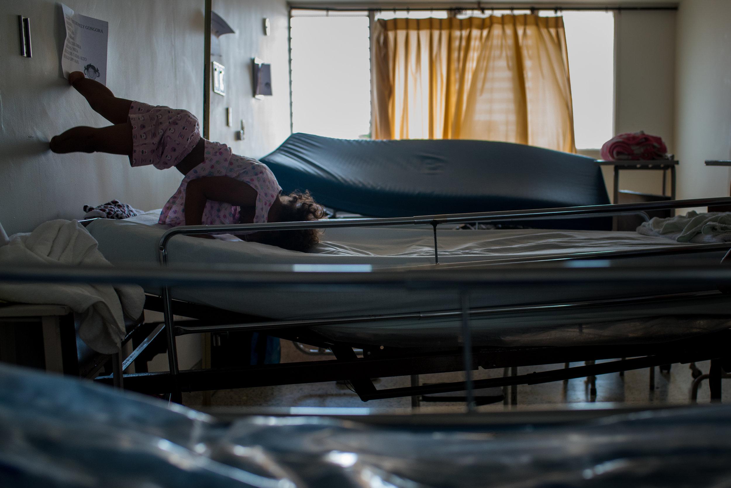 Ebony, at age 3, climbs the wall in the  FundacionHospital San Jose de Buga,  waiting for her 4th surgery.