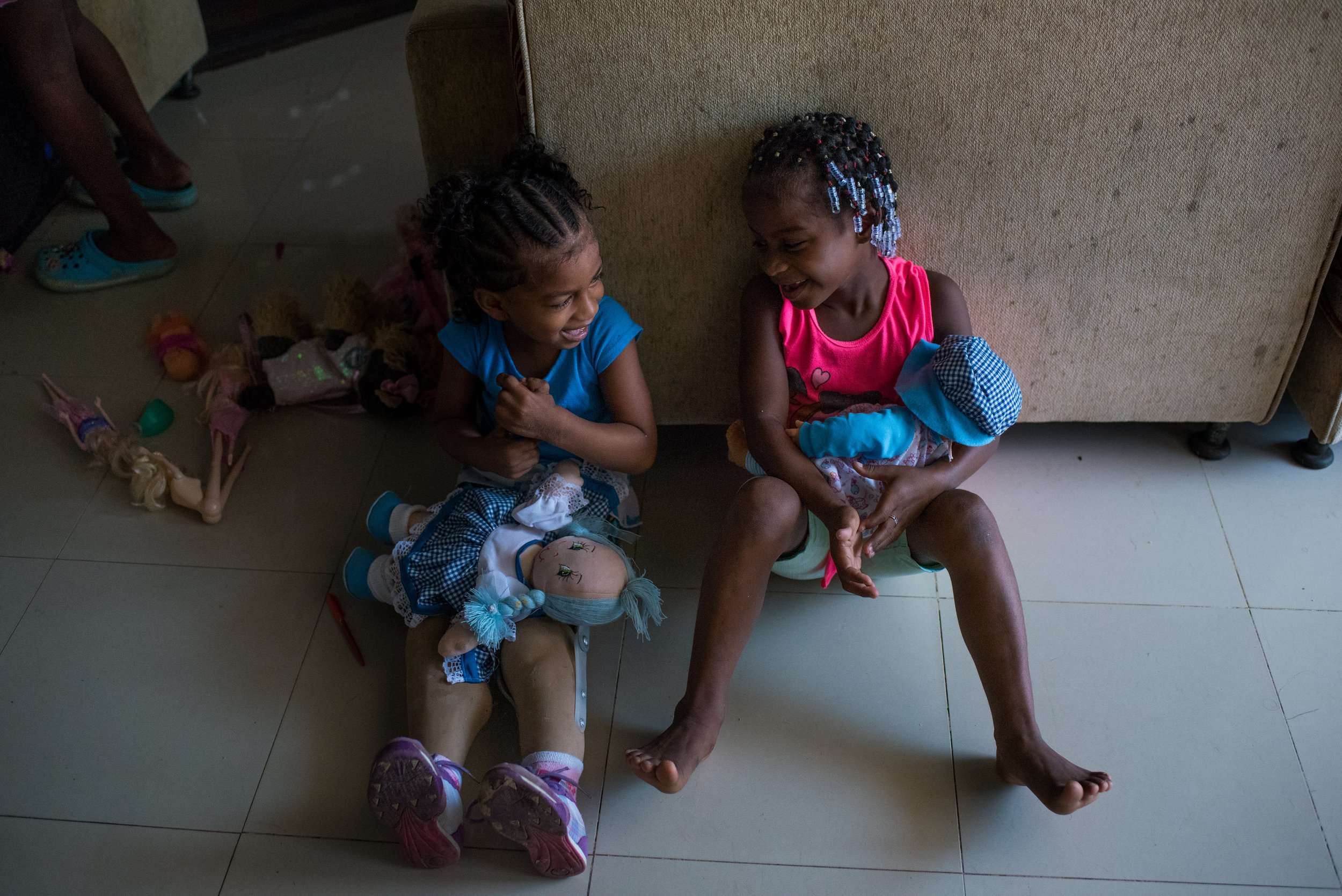 Ebony and her friend play with dolls. By age 3.5, Ebony's surgeries have helped her to live a life where she is capable of participating in everyday activities.