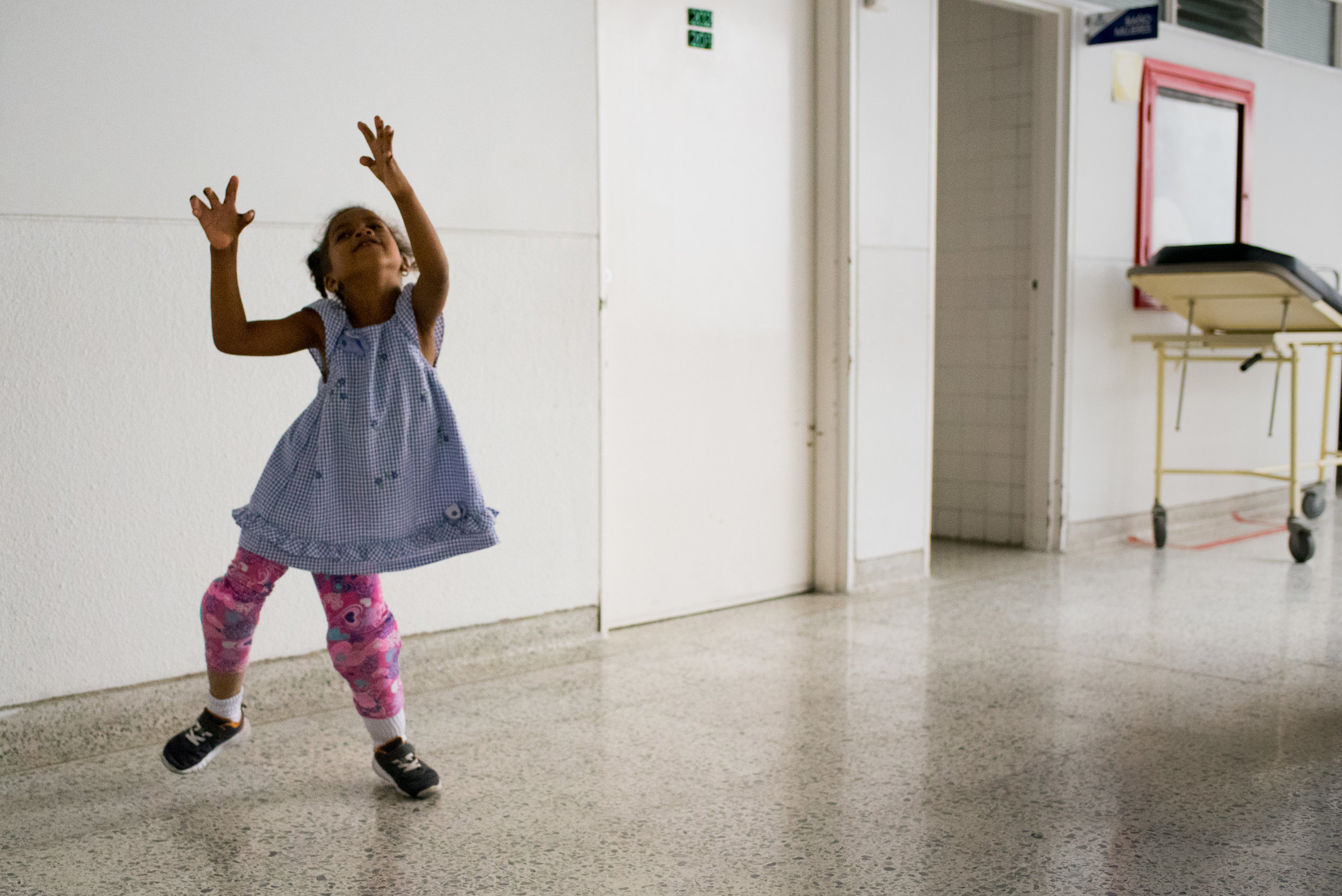 Ebony dances in the hospital corridor before she goes in for the last hand surgery.