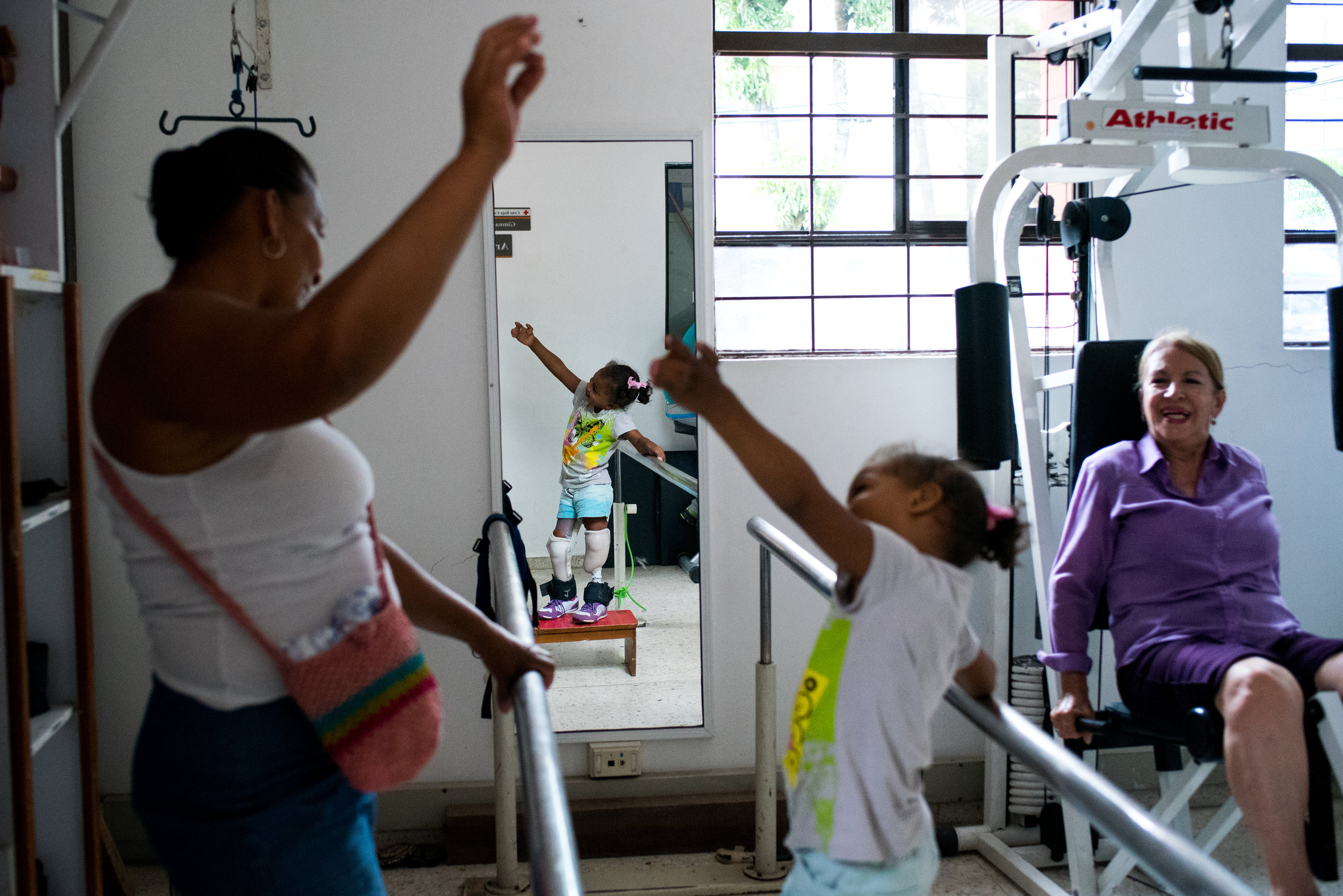 Ebony and Julia during one of her physical therapy sessions at the CRUZ ROJA, where she learns to walk with her prosthetic legs.