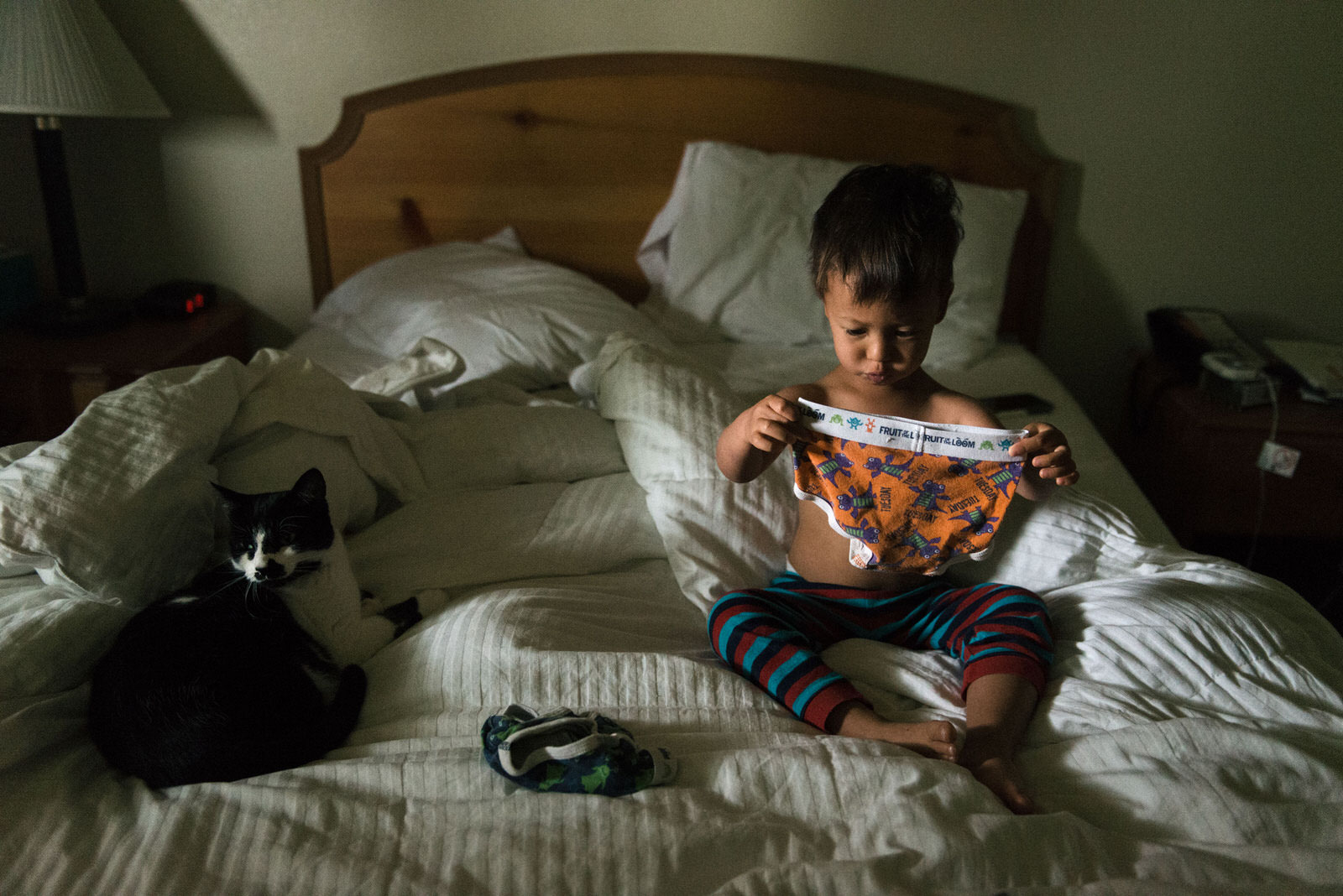 Age 2. After waking up, Harry selects his clothing for the day. He ponders underwear before moving onto pants and shirts.
