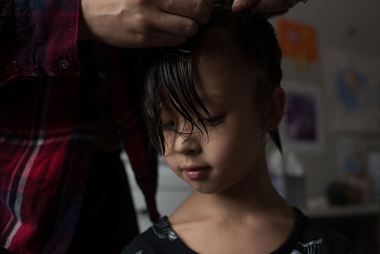 Age 6. For years, he has asked for long hair. He asks that we stop taking him for hair cuts and we oblige. After 5 months, it is long enough to braid. I water it down while combing it to make it easier to braid.