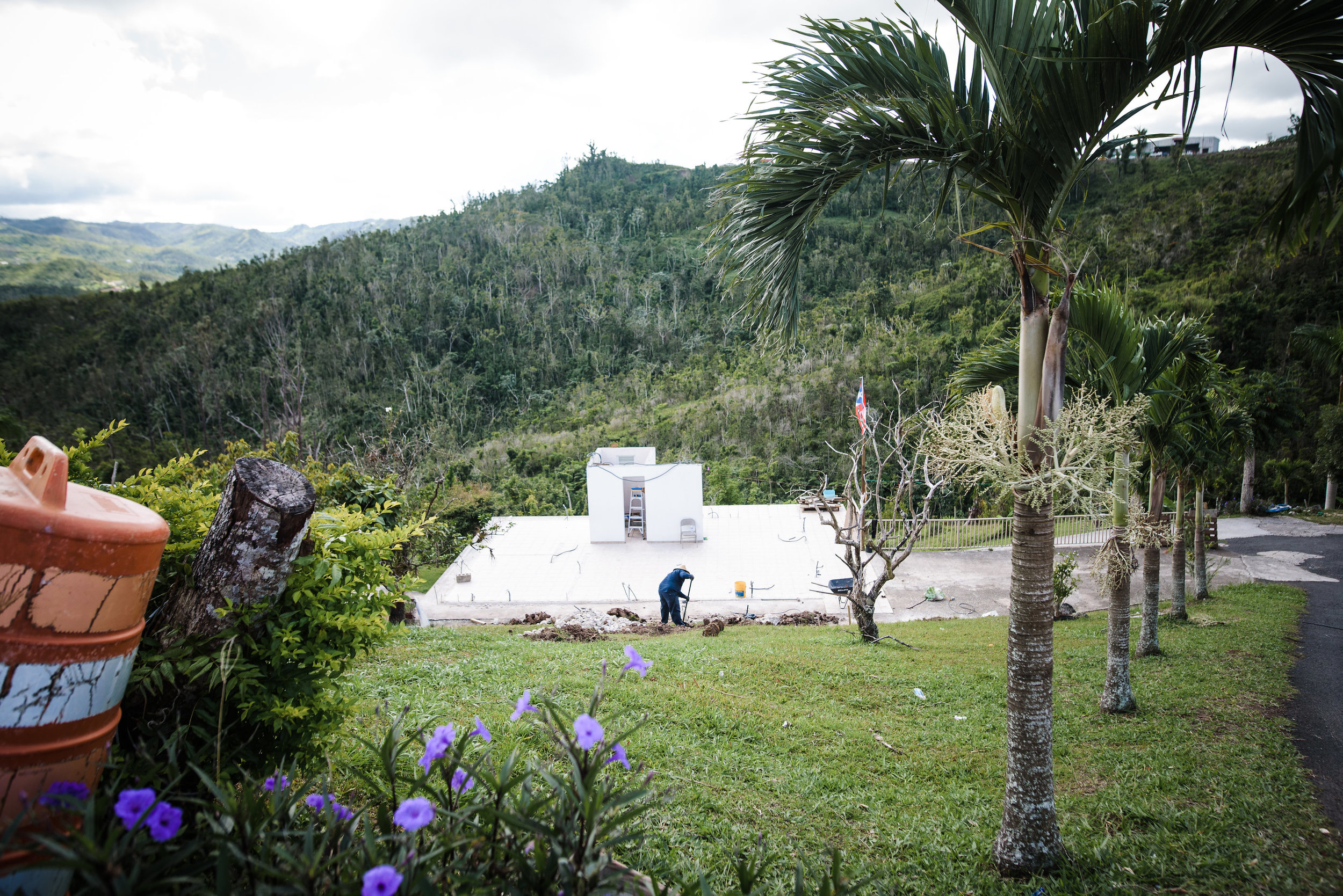 Juan Hernandez, a truck driver from Orocovis, PR, works alone on rebuilding his home that he built just 10 years ago. The house was blown away with the hurricane and parts of the home can be seen in the valley below.Photo: Aniya Emtage Legnaro