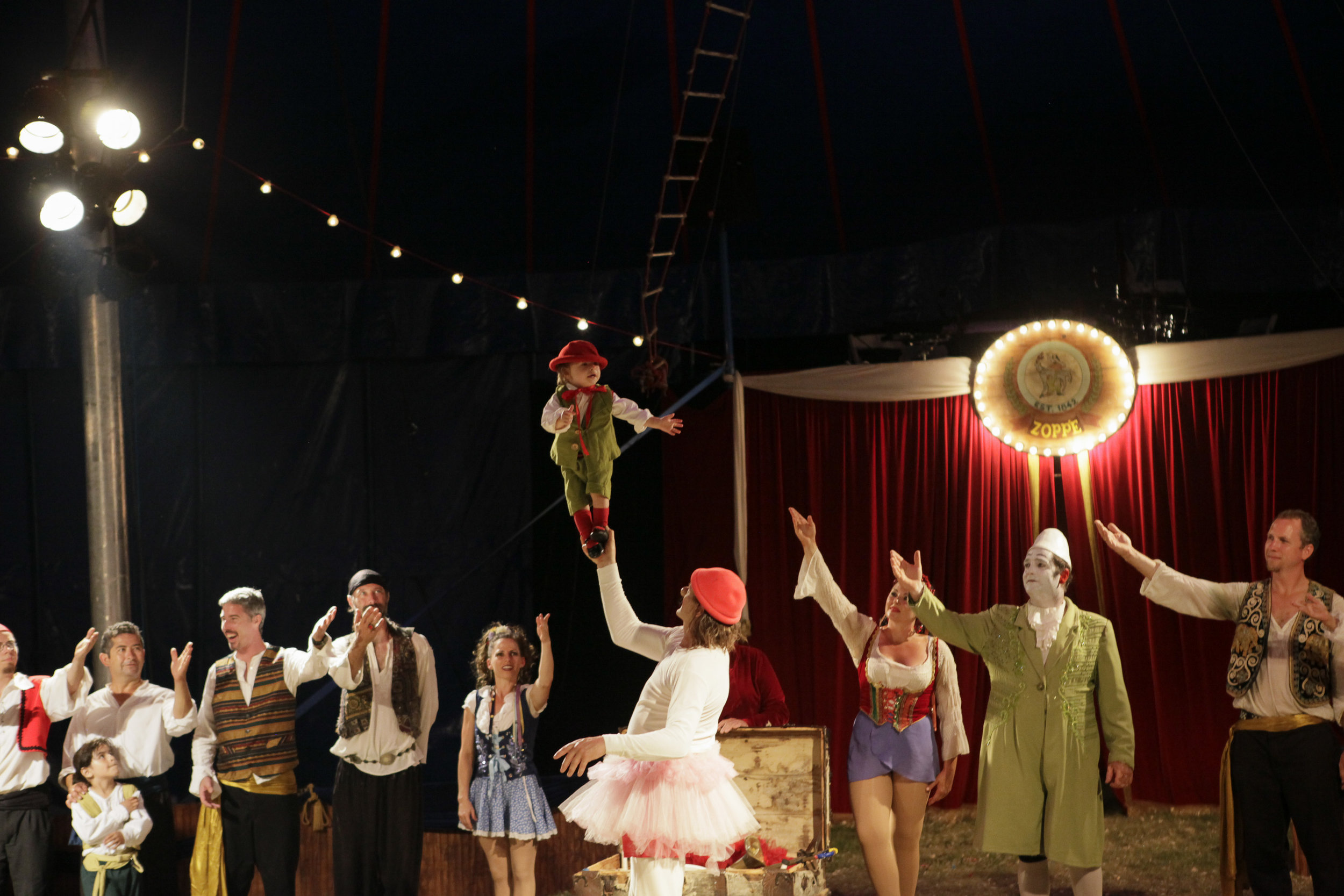 As the troupe take their final bows, Giovanni, in character as Nino dressed as an equestrian ballerina, presents young Julien for applause. Rhythms of life for circus families are out of the norm—even the littlest kids stay up late and are encouraged to take risks—but their extended family is there to support them all day every day.
