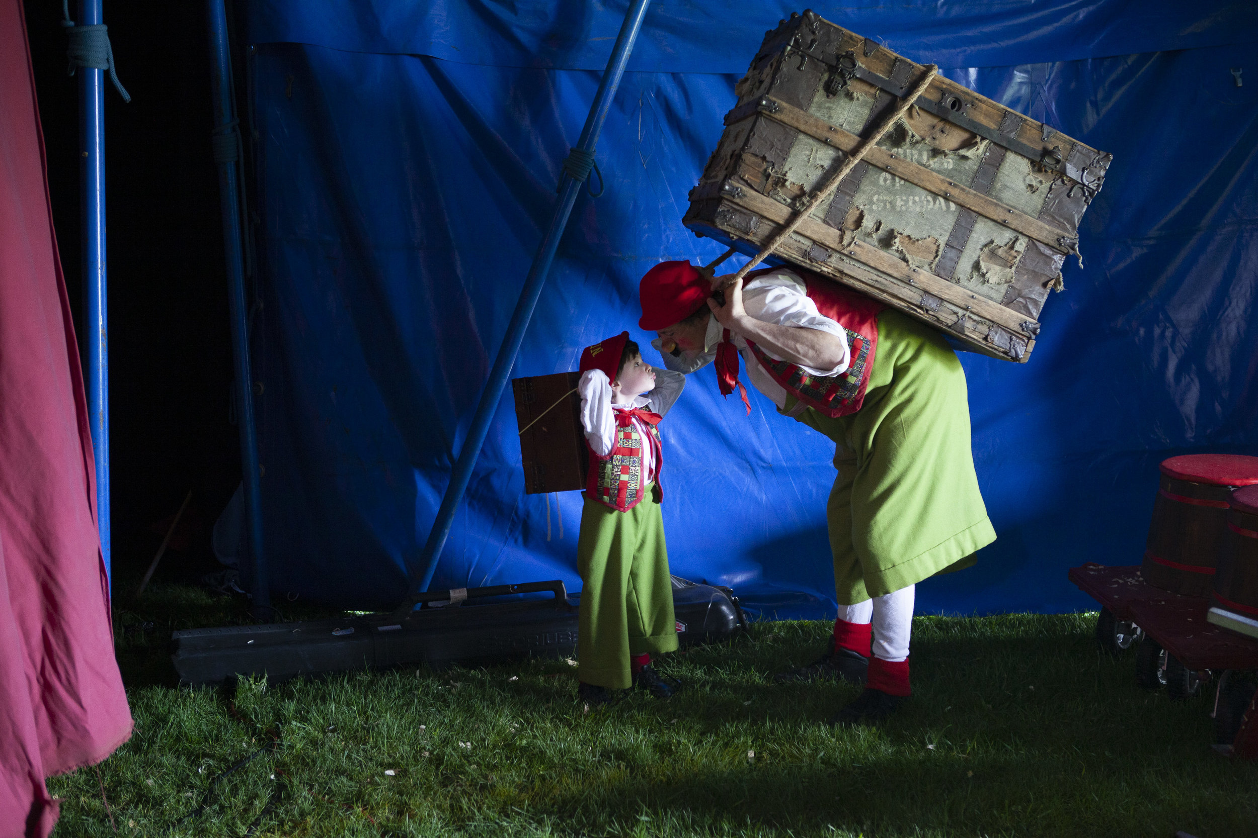 A backstage kiss for good luck transforms Julien and Giovanni into Ninito and Nino as they enter the ring to kick off the show. On their backs, matching steamer trunks—Julien's small and empty, Giovanni's full of implements for the show, all carefully packed into his father's trunk from Italy, tying together generations of Zoppé circus performers.
