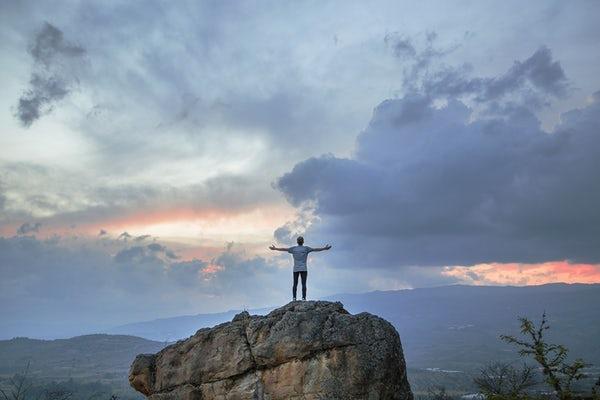Man on rock prayer pic.jpg