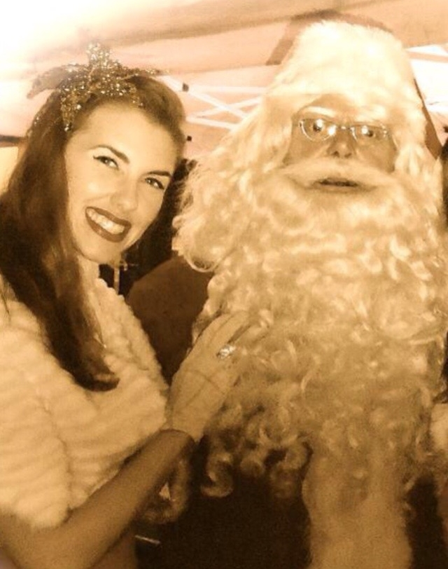 Vintage Singer Bunny Nightingale with Santa Claus at a Christmas Party Event