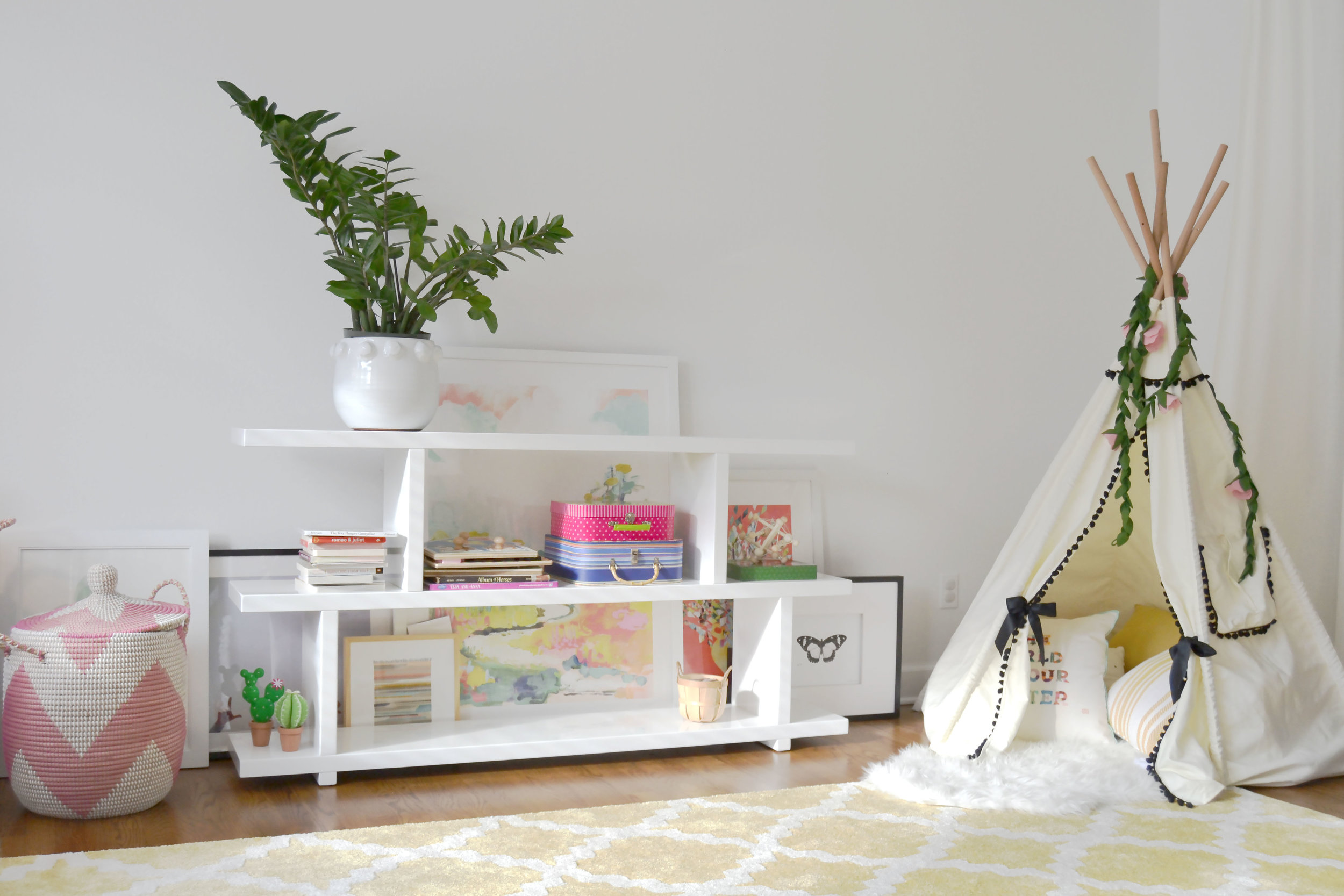 playroom bookshelves and teepee.jpg
