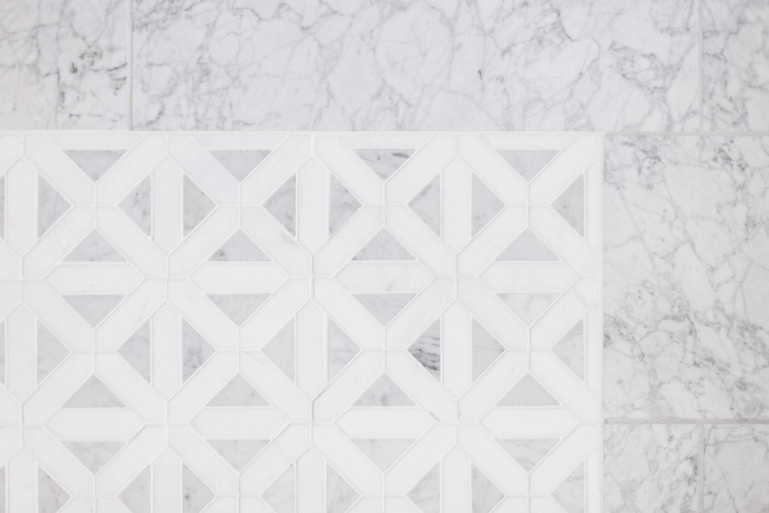 Marble flooring in a Modern Master Bath Remodel by Harper Rae Design Co