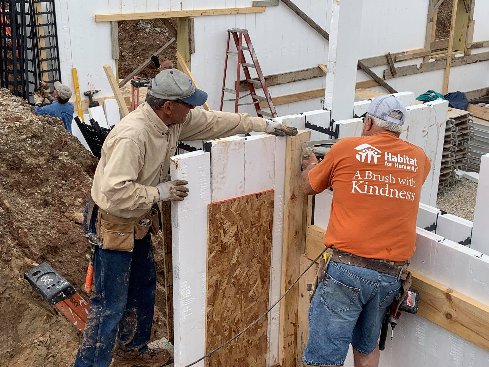 Volunteers with Habitat for Humanity Door County work on forms for the foundation.