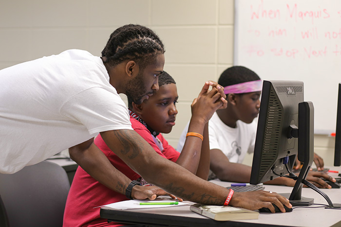 Marquis working with students in our Summer Enrichment program.