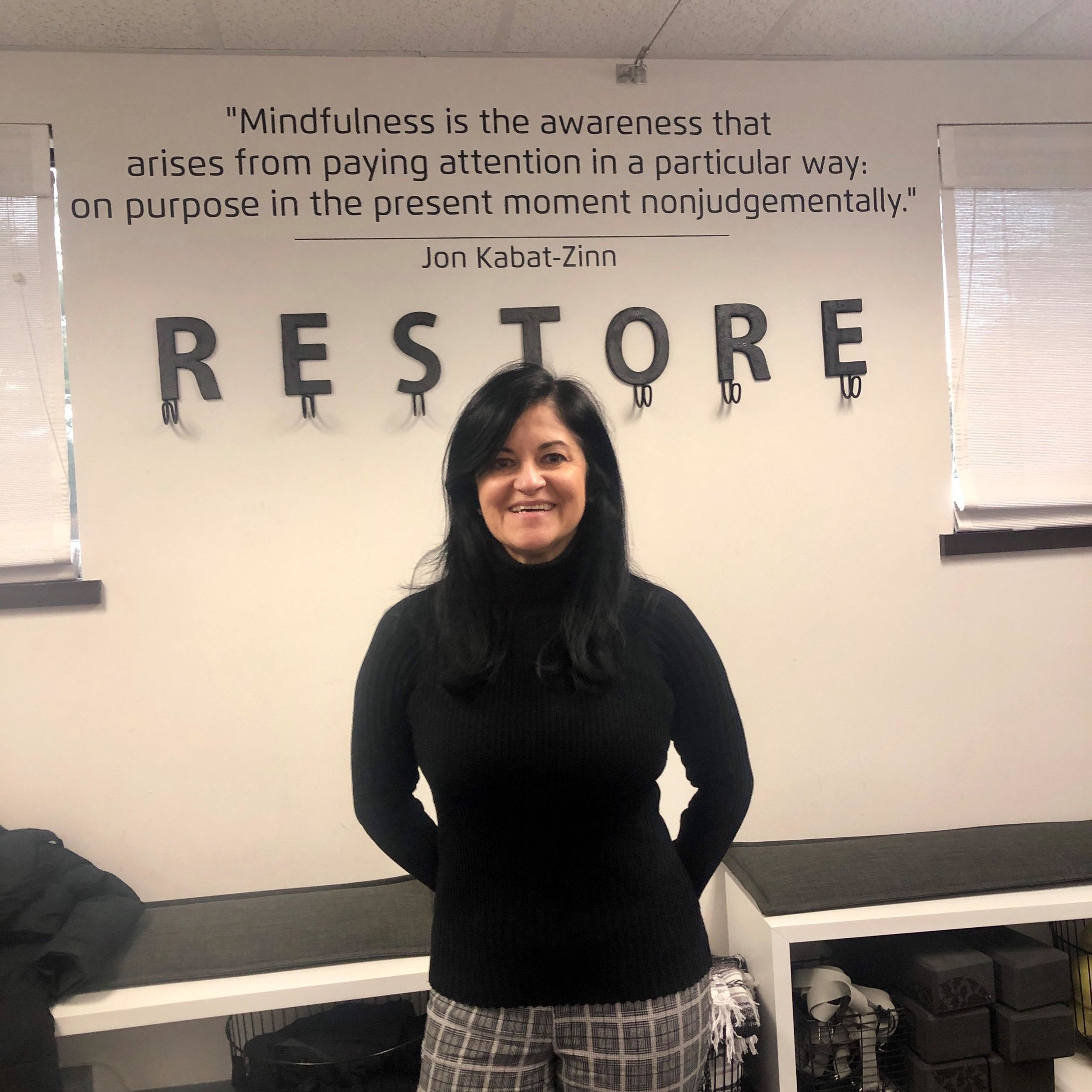 Val leading an onsite mindfulness and meditation training with restore meditation