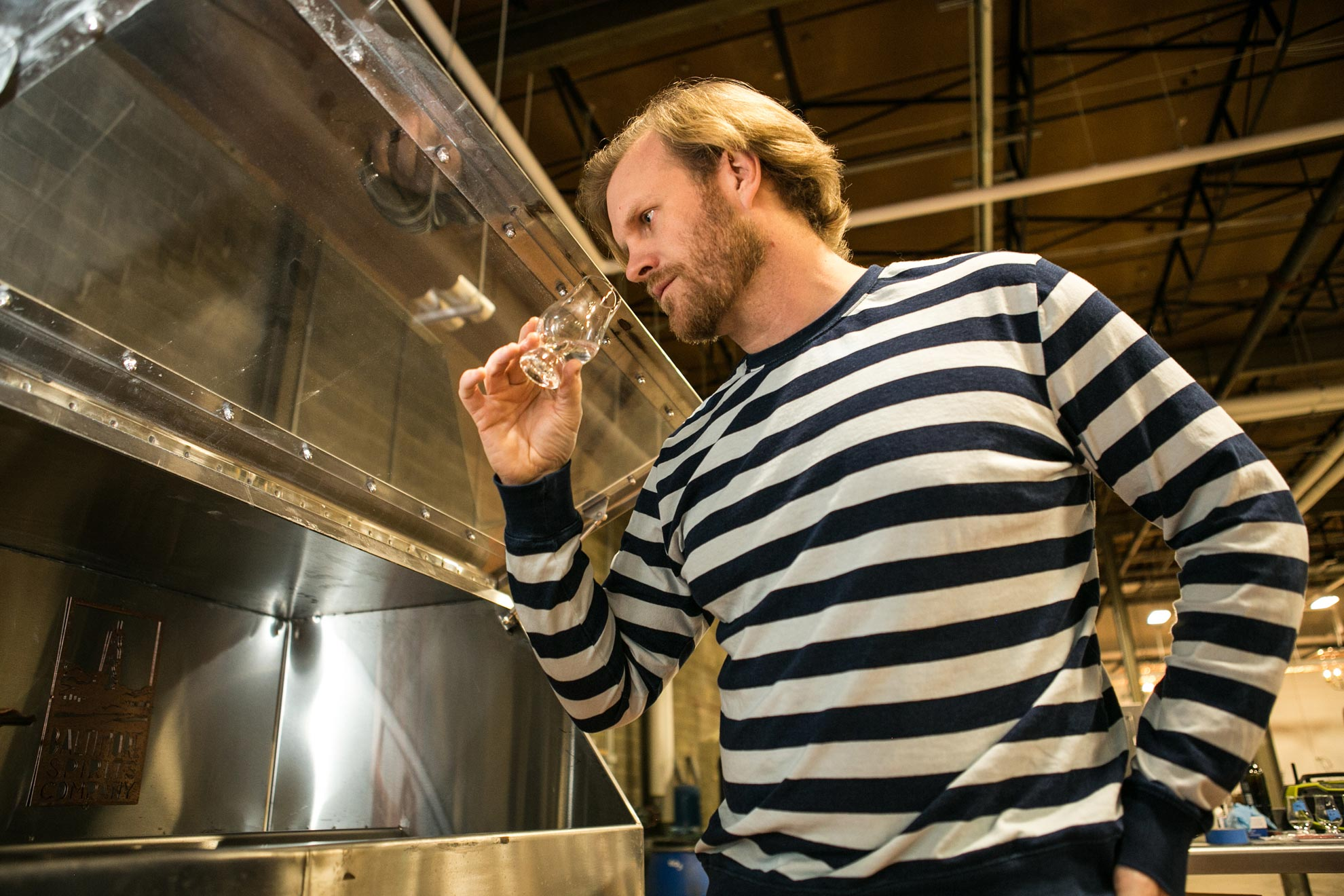 Max Lents of Baltimore Spirits Company quality checks a batch of their craft gin.
