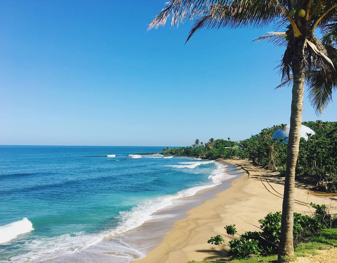 One of the many beautiful beaches found in Rincon, Puerto Rico. Photo via Cait Lawson @sunburntandsalty