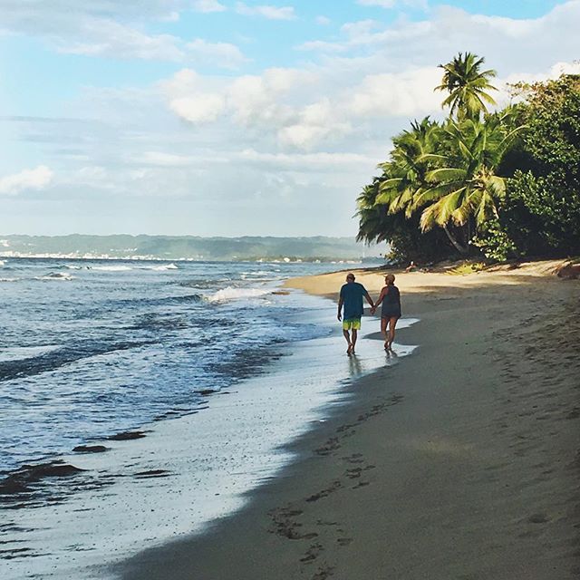 """Long walks on the beach are a must when visiting Rincón 🌴 Did you know we offer both a Master Suite and a King Suite option that's perfect for couples, partners, & friends?? Signing up as a """"pair"""" ensures you a discount, as well as signing up on/before February 15th! 🥰 Tap the link in our bio or DM us for more info! . . . .  #buenavida #yogaretreat #rinconpuertorico #buenavidaretreats #estaeslabuenavida #wellnessretreat #caribbeanyogaretreat #beachfrontyoga #thisisthegoodlife #couplesyoga #valentinesday #investinyourwellness #meditation #localfood #adventures #travel #authenticconnection #resetandrecharge #prlovesyoga"""