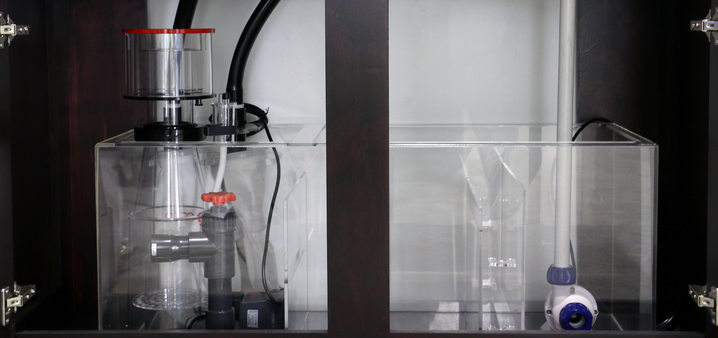 A sump filtration system with protein skimmer (left) and return pump (right). ecotech vectra available at additional charge