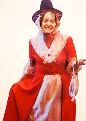 Susan Davies Sit in traditional Welsh dress.