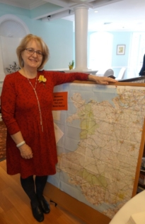 WSWNE President Susan Davies Sit, with our Welsh map of members' Welsh roots.
